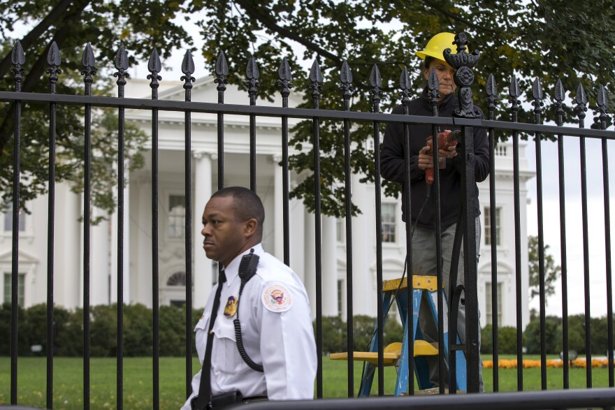 A Secret Service police officer walks outside the White House in Washington on Thursday.