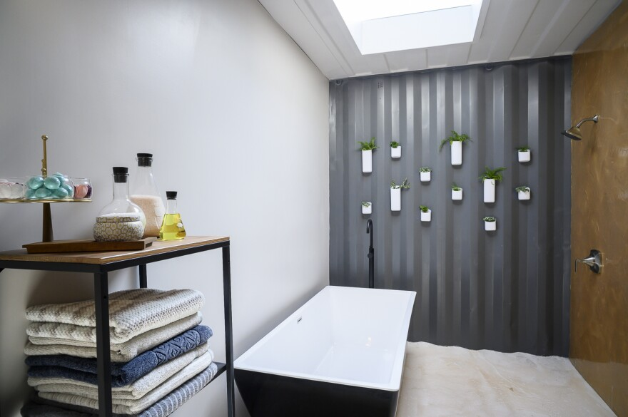 This bathroom makes the most of the shipping containers' rippled steel structure.