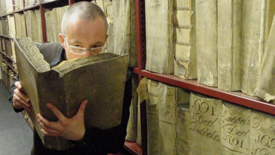 Professor Matija Strlic of the Odeuropa team smells a historic book in the National Archives of The Netherlands.