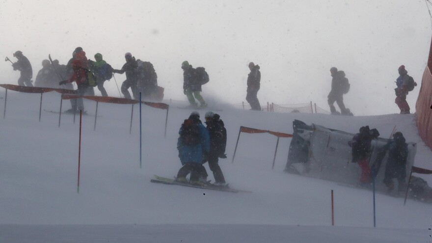 Windy conditions at the Yongpyong Alpine Center forced the delay of the women's slalom race. Here, team members and coaches are seen on the mountain as gusts of wind blew Wednesday morning.
