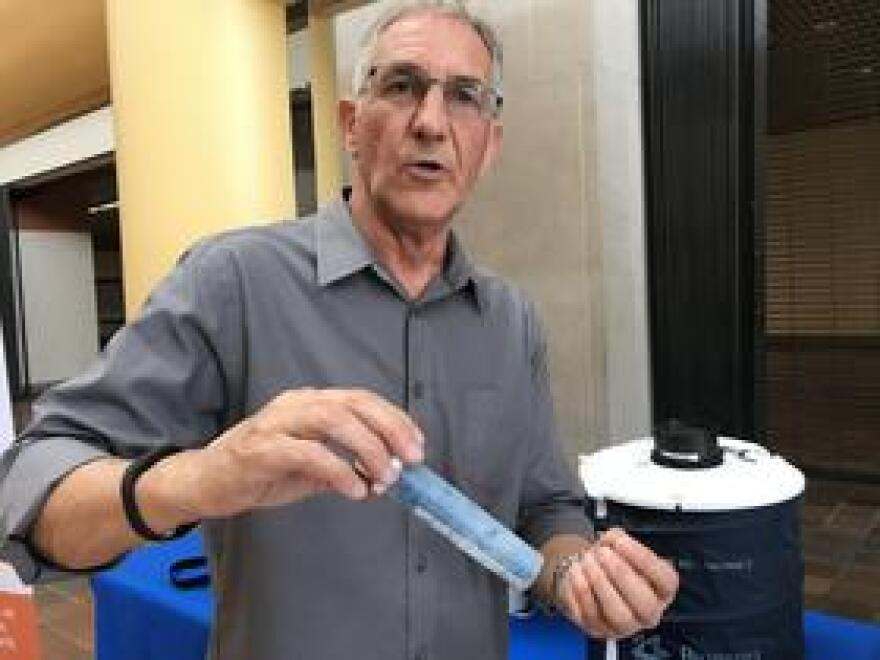 Bill Petrie, director of mosquito control for Miami-Dade County, shows off one of the traps used to catch and collect data on mosquitoes.