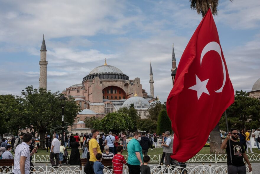 A man waves Turkey's national flag in front of the Hagia Sophia on the fourth anniversary of the July 15, 2016 failed coup attempt in Istanbul, Turkey. Turkish President Recep Tayyip Erdogan recently ordered the Hagia Sophie to be open for Muslim prayers.