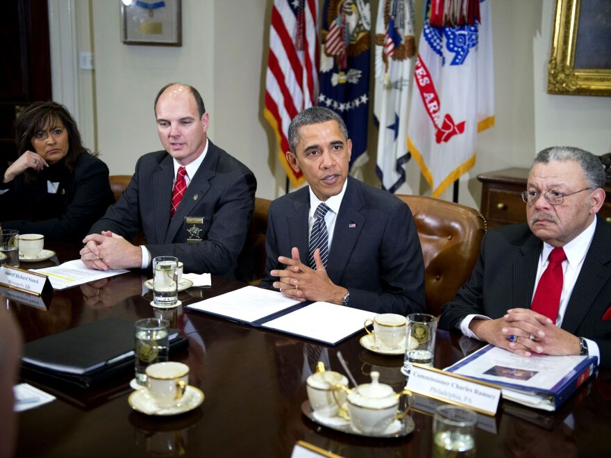 President Obama and law enforcement officials meet in January to discuss gun violence. To the left of Obama is Hennepin County, Minn., Sheriff Richard W. Stanek; to the right is Charles H. Ramsey, commissioner of the Philadelphia Police Department.