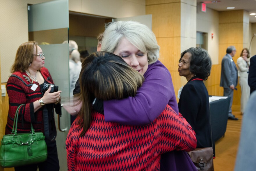 Missouri School Boards' Association Executive Director Melissa Randol hugs St. Louis school board member Donna Jones after the state school board voted Tuesday, April 16, 2019 to return governance of St. Louis Public Schools back to the elected board.