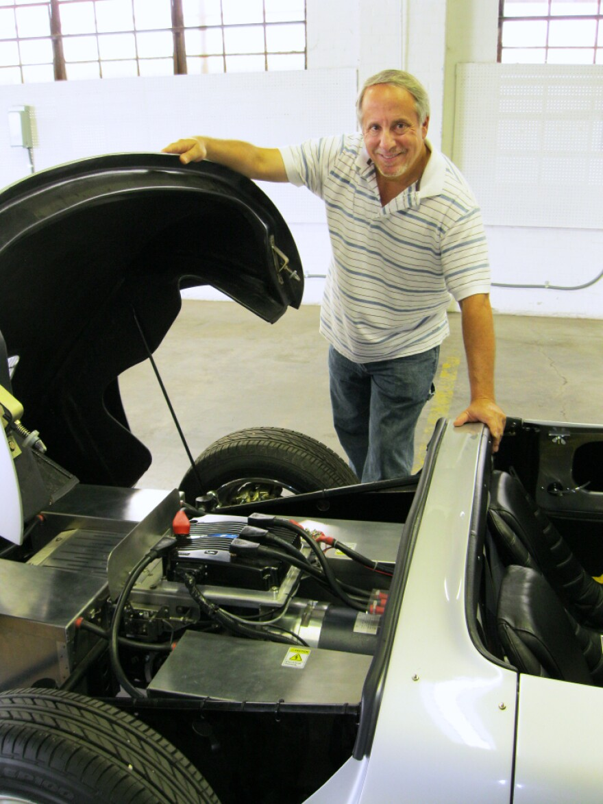 Brian Noto shows what's going on under the hood of a replica 1957 Porsche 356 Speedster in EVTV's Cape Girardeau, Mo., garage. The car runs on lithium iron phosphate batteries.