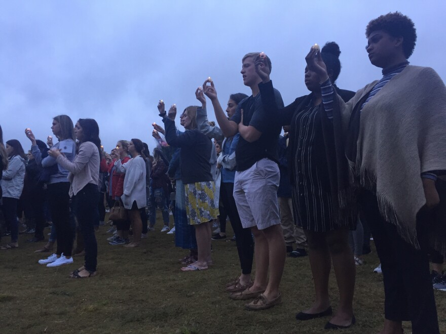 Florida State University students lit candles to remember two victims killed in a Tallahassee shooting Friday.