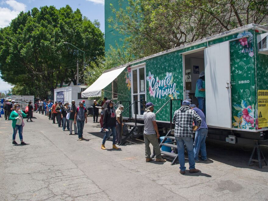 People line up to receive food last month at a food truck outside La Raza National Medical Center in Azcapotzalco in northern Mexico City.