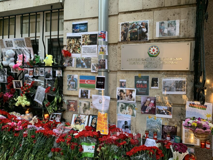 Flowers, stuffed animals and photographs of victims of the renewed fighting over Nagorno-Karabakh have piled up outside the Azerbaijani Embassy in Moscow.