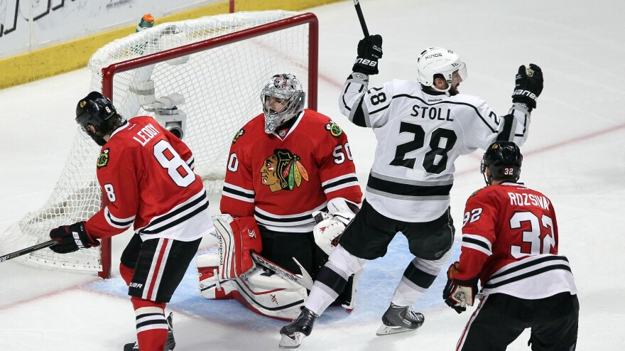Jarret Stoll (No. 28) of the Los Angeles Kings celebrates his team's game-winning goal in Game 7 of the Western Conference Finals. Kings defenseman Alec Martinez scored in overtime with a shot that deflected off the Chicago Blackhawks' Nick Leddy (left).