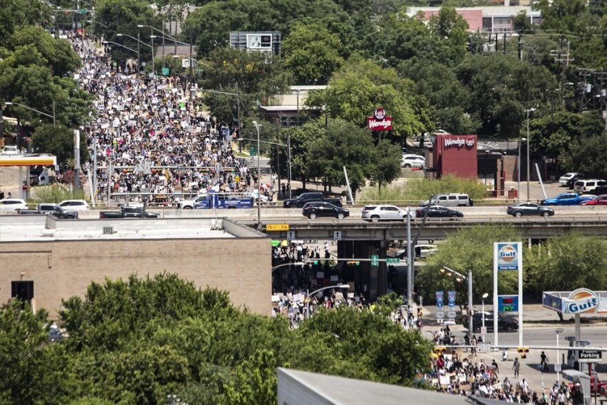 Thousands march from Huston-Tillotson University to the Texas State Capitol as part of the March for Black Lives.