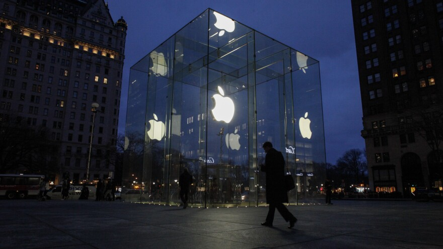 A man walks outside the Apple store on Fifth Avenue in New York City on Wednesday.