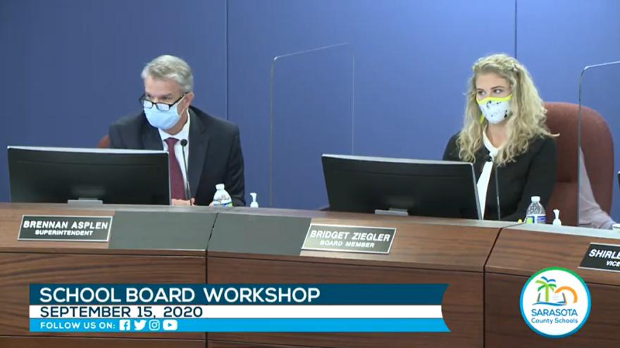 School superintendent Brennan Asplen and school board member Bridget Ziegler wear masks at the school board workshop