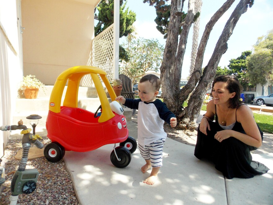 Kerri De Nies plays with her son, Gregory Mac Phee at their home in San Diego. Gregory tested positive for adrenoleukodystrophy, a rare brain disorder that affects 1 in about 18,000 babies. Roughly 30 percent of boys with the genetic mutation go on to develop the most serious form of the disease.