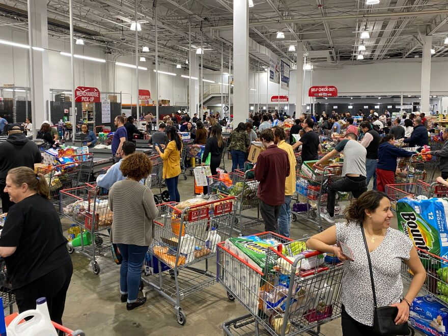 Shoppers line up with full carts in a supermarket in Virginia on March 13, 2020.
