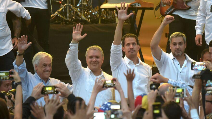 "From left: Chilean President Sebastián Piñera, Colombian President Iván Duque, Venezuela's opposition leader Juan Guaidó and Paraguayan President Mario Abdo Benítez wave at the ""Venezuela Aid Live"" concert in Cúcuta, Colombia, on Friday."
