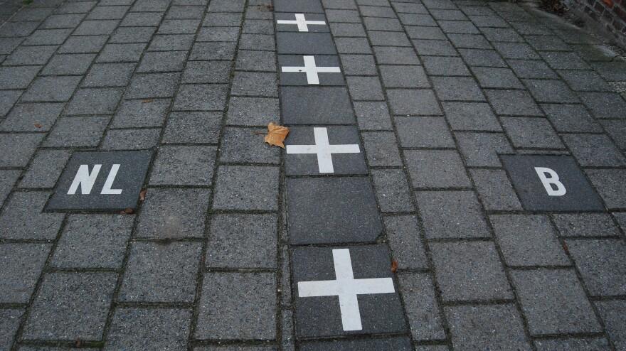Netherlands/Belgium border painted on the sidewalk in Baarle-Nassau.