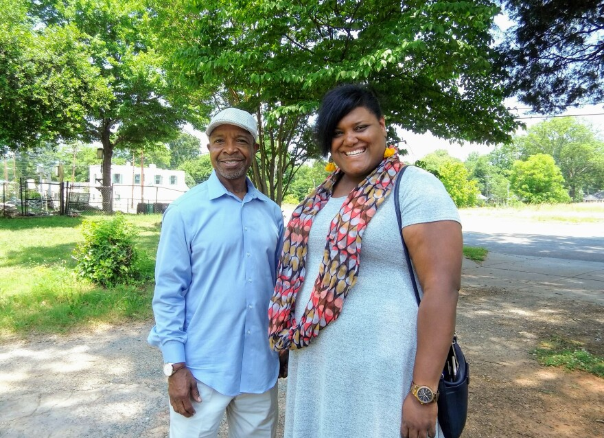 Rickey Hall (left) is chair and Charis Blackmon is executive director of the West Charlotte Community Land Trust. They're on the trust's first property, on Tuckaseegee Road.