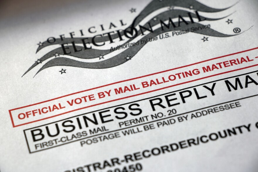 A closeup of a Vote by Mail envelope.