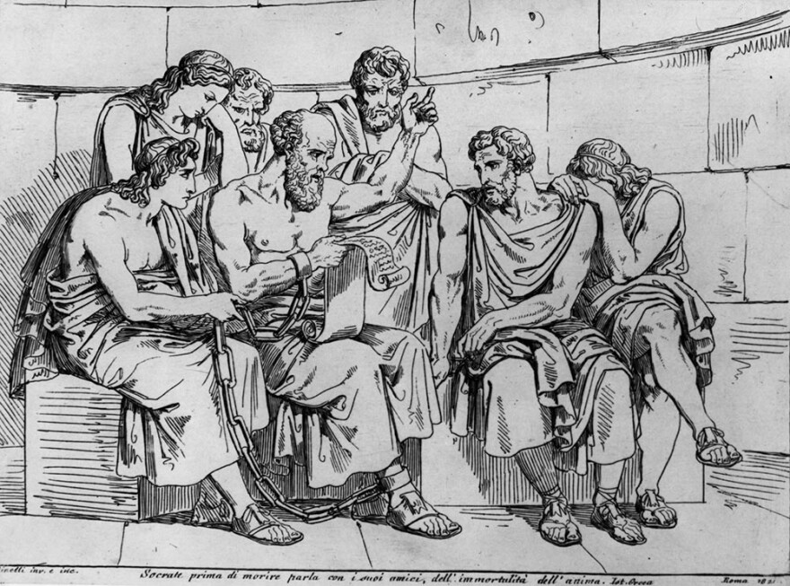 Circa 410 BC, The Greek philosopher Socrates (469 - 399 BC) teaches his doctrines to the young Athenians whilst awaiting his execution. Original Artwork: An engraving after a painting by Pinelli. (Hulton Archive/Getty Images)
