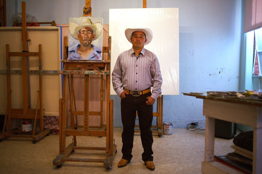 Francisco Melgar says he sees himself — his eyes, his face — in the portrait painted by John Sonsini.