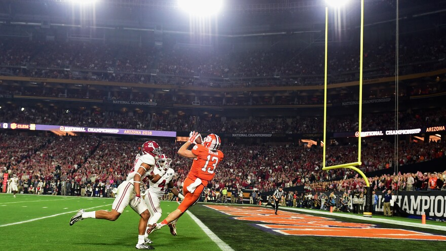 Hunter Renfrow of the Clemson Tigers catches a 31-yard touchdown pass from Deshaun Watson in the first quarter Monday against the Alabama Crimson Tide during the 2016 College Football Playoff National Championship Game in Glendale, Ariz.