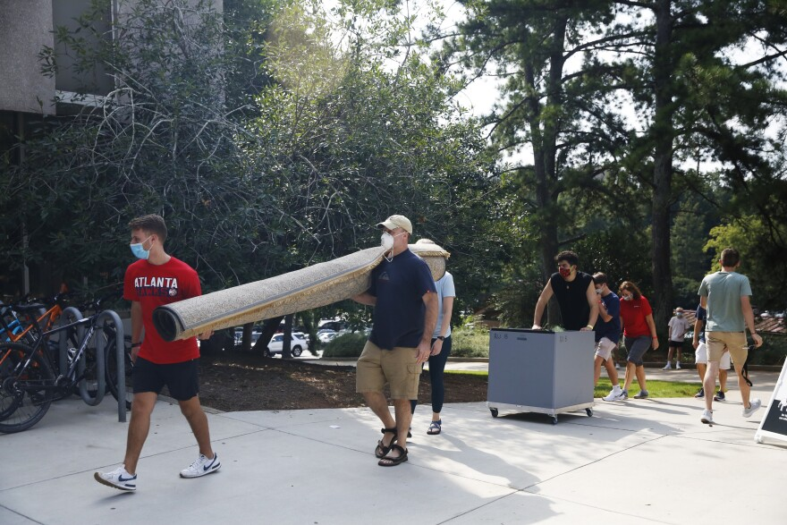 Students move into dorms on Monday at the University of Georgia in Athens.