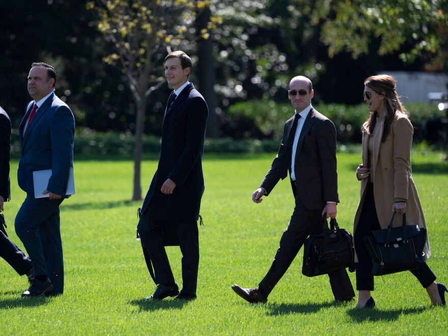 Assistant to the President and Director of Oval Office Operations Nicholas Luna, Assistant to the President and Deputy Chief of Staff for Communications Dan Scavino, Senior Advisor to the President Jared Kushner, Senior Advisor to the President Stephen Miller, and counselor to the President Hope Hicks walk to Marine One to depart from the South Lawn of the White House on Sept. 30.
