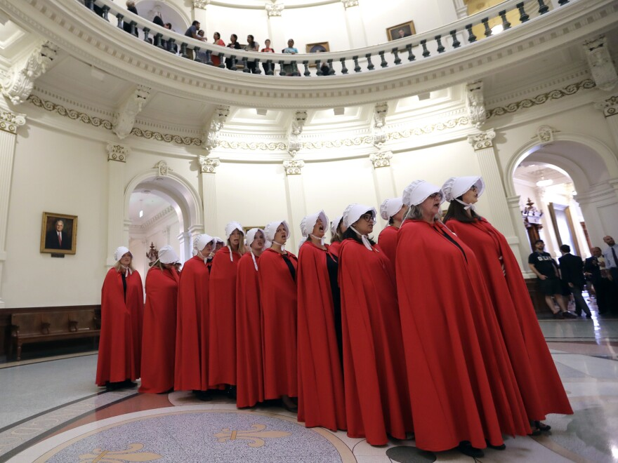 """Demonstrators dressed as characters from """"The Handmaid's Tale"""" to protest SB8 at the Texas Capitol in May."""