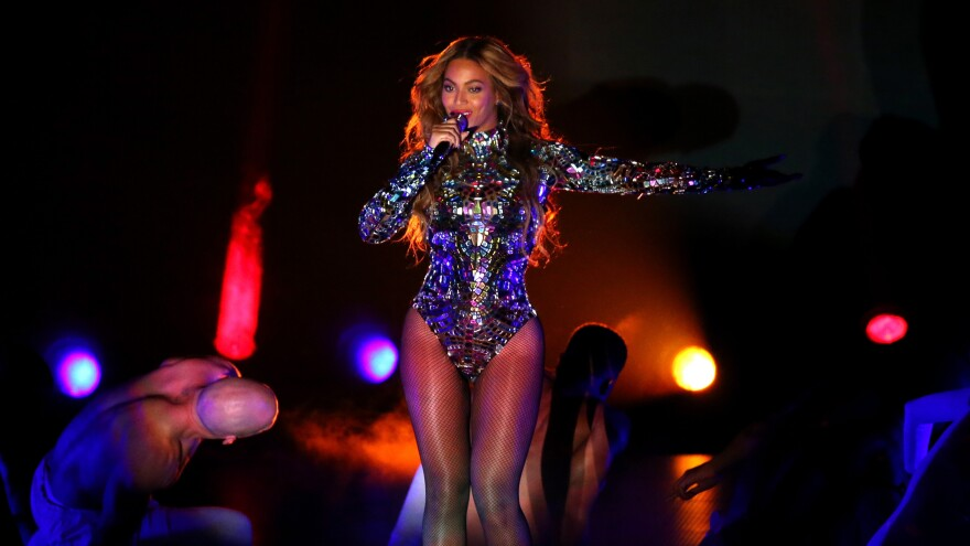 Beyonce performs onstage during the 2014 MTV Video Music Awards. The singer is up for six Grammy Awards, including Album of the Year.