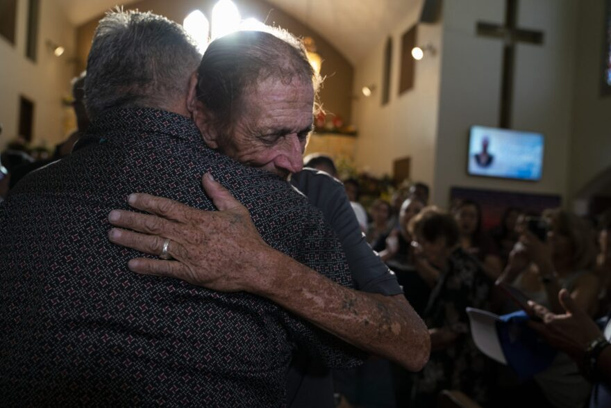 Antonio Basco greets one of the hundreds of El Pasoans who attended the funeral for his wife, Margie Reckard, who was killed in the El Paso Walmart mass shooting.