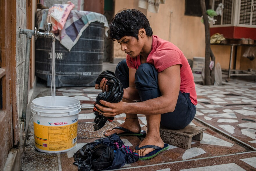 Neetu washes clothes in her rented room in Rohtak, India, where she lives (and trains) during the week. On weekends, she goes home to her village to be with her family.