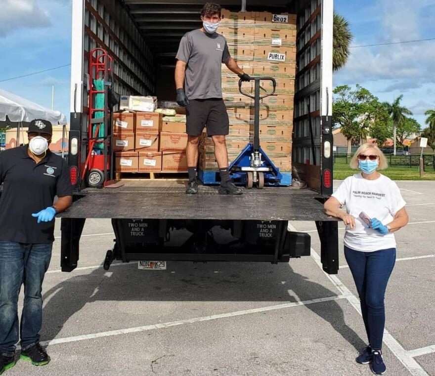 Councilperson Douglas Lawson (far left) and Deborah Morgan, Executive Director of Palm Beach Harvest Food Bank (far right)