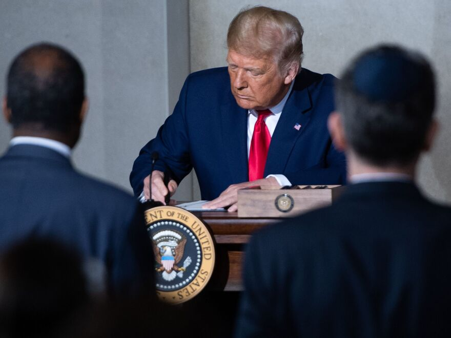 President Trump holds a Constitution Day proclamation after speaking Thursday during the White House Conference on American History at the National Archives in Washington, D.C.