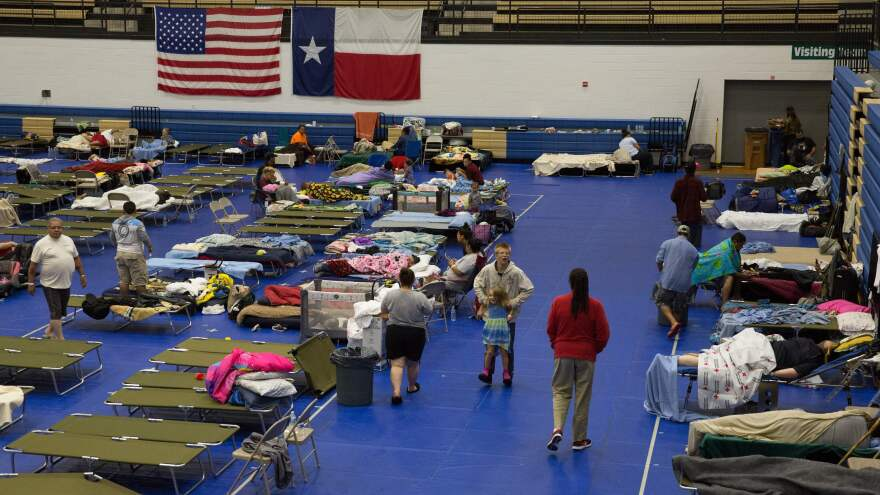 Evacuees from Hurricane Harvey gather at the Delco Center in Austin, Texas, on Sunday. The Red Cross says there were 185 people at this location but that it is prepared to handle up to 350 people if needed.