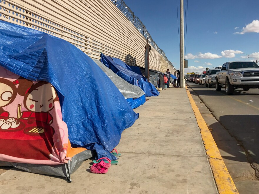 Makeshift tents against the border wall in San Luis Río Colorado, Mexico, where migrants are waiting for a chance to apply for asylum.