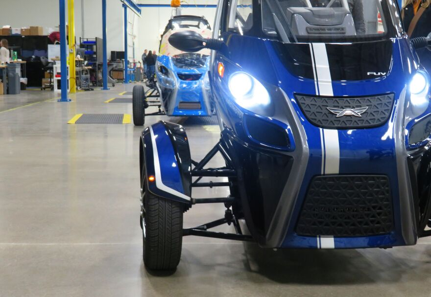 A row of Acrimoto's distinctive three-wheeled electric vehicles sit in its Eugene factory.