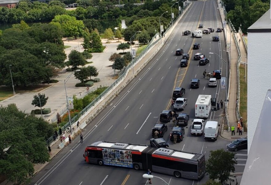 The South First Street bridge in downtown Austin is closed in both directions as more than a dozen law enforcement units respond to a situation.
