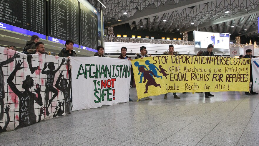 Demonstrators protest against the deportation of refugees back to Afghanistan at the Frankfurt, Germany, airport Wednesday night.