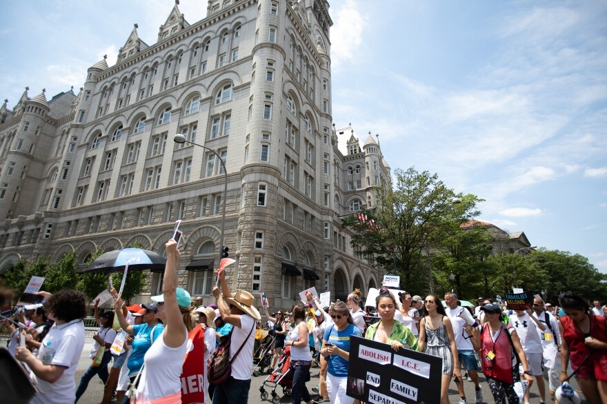 Demonstrators braved the heat to march in protest of the Trump administration's immigration policies.