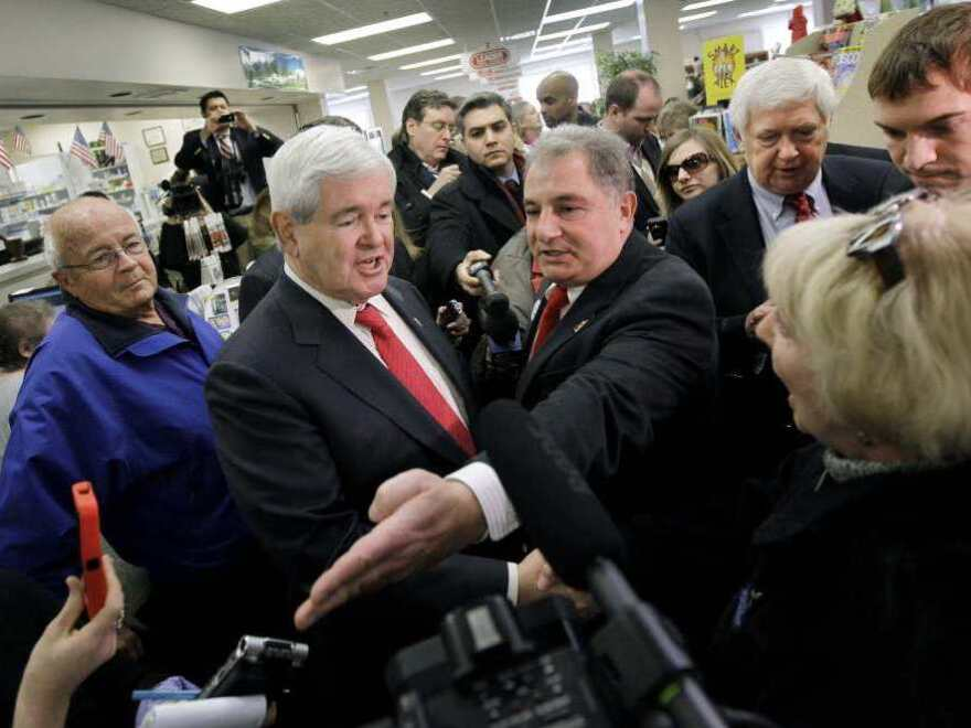 Newt Gingrich in a Hollis, N.H. pharmacy, Monday, Dec. 12, 2011.