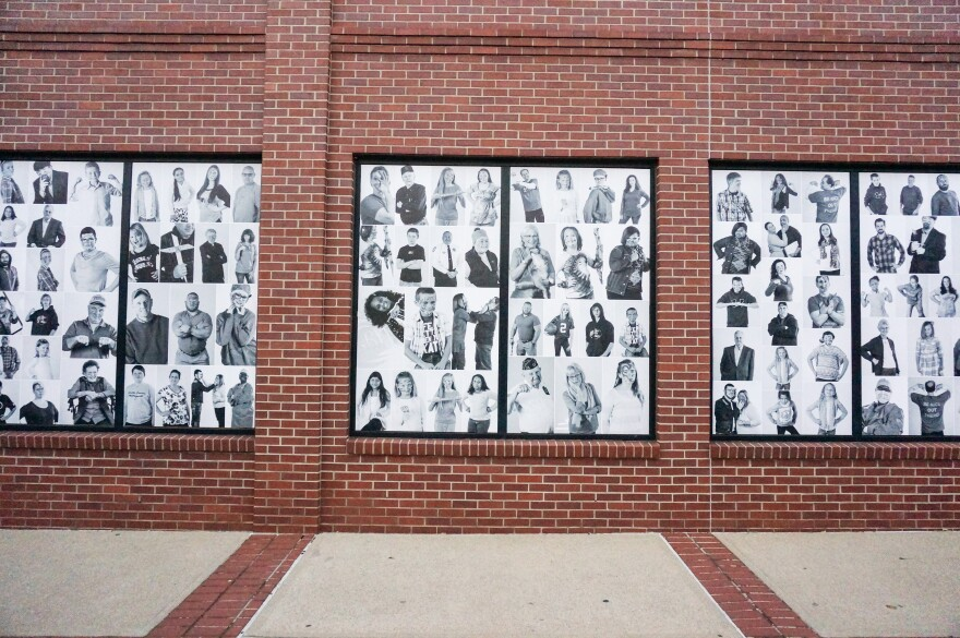 The sheer volume of photos on the windows is striking.