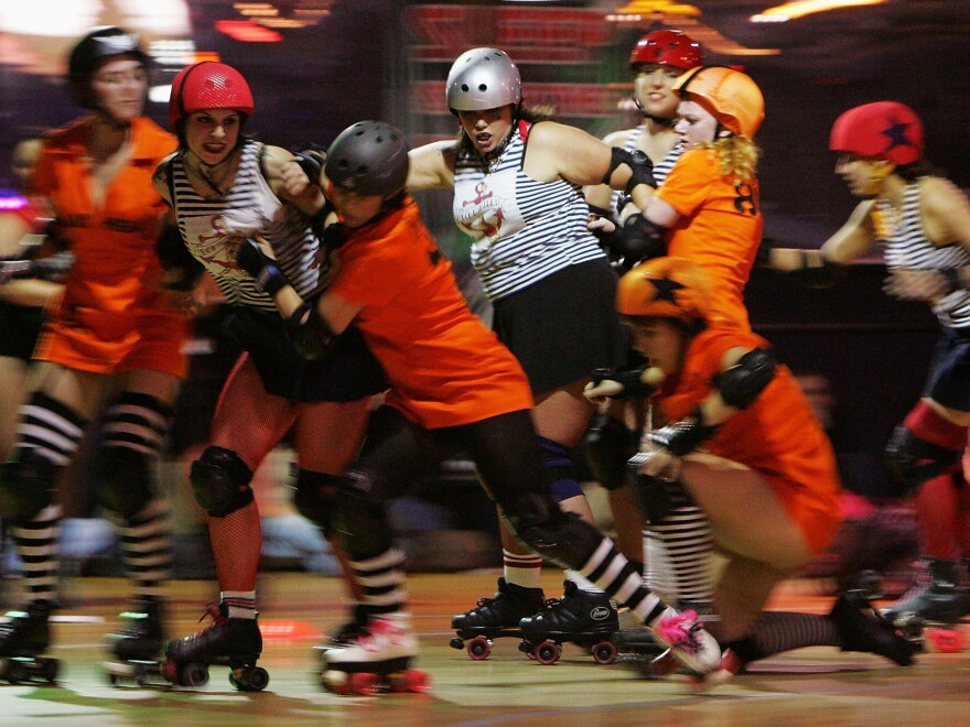 Roller derby teams Brooklyn Bombshells and the Manhattan Mayhem get tangled up in a New York City bout in 2004.