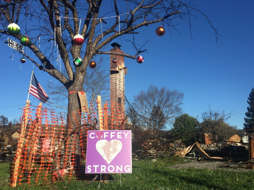 The Howe family and neighbors returned to their old neighborhood to put Christmas decorations on one of the few trees left standing after the fire.