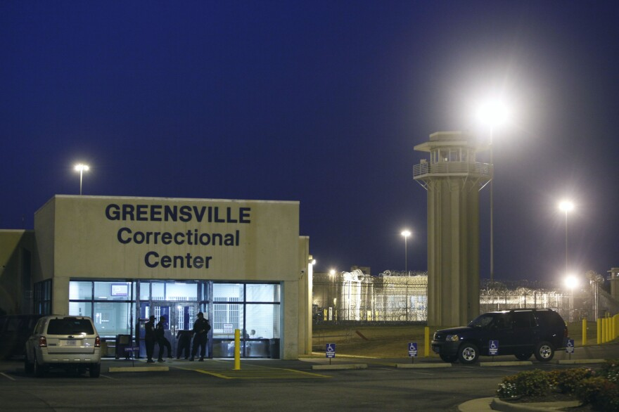 Prison guards stand outside the entrance to the Greensville Correctional Center where executions are carried out, in Jarratt, Va., on Sept. 23, 2010. This week, lawmakers in Virginia voted to abolished the death penalty.