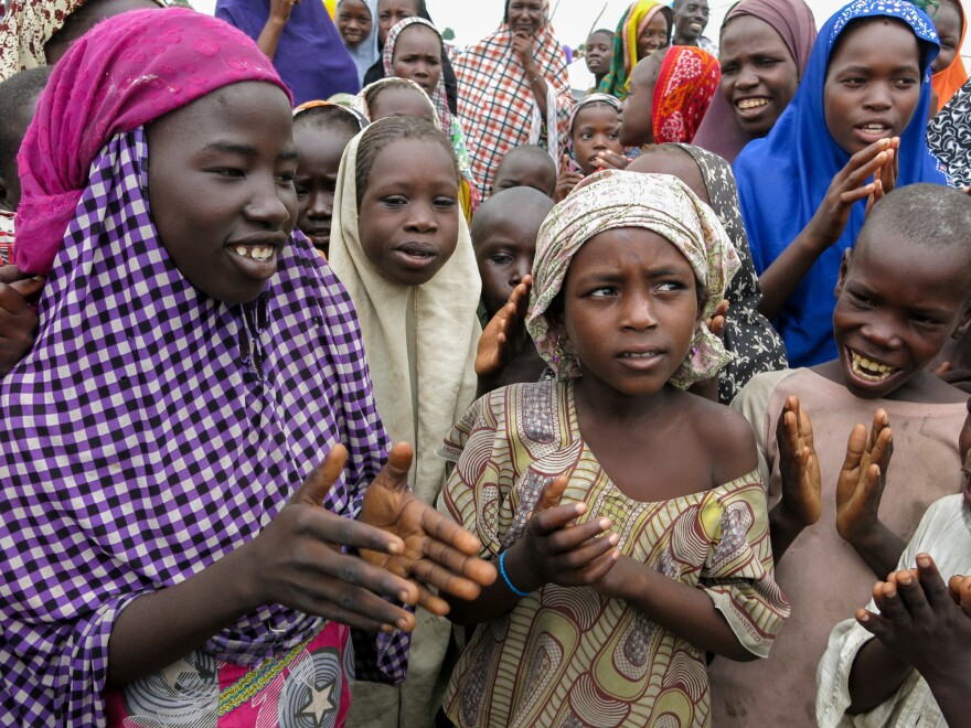 They're not in class, so to while away the time Maimuna Bundi<strong>, </strong>second from right, sings with her friends at Muna camp.
