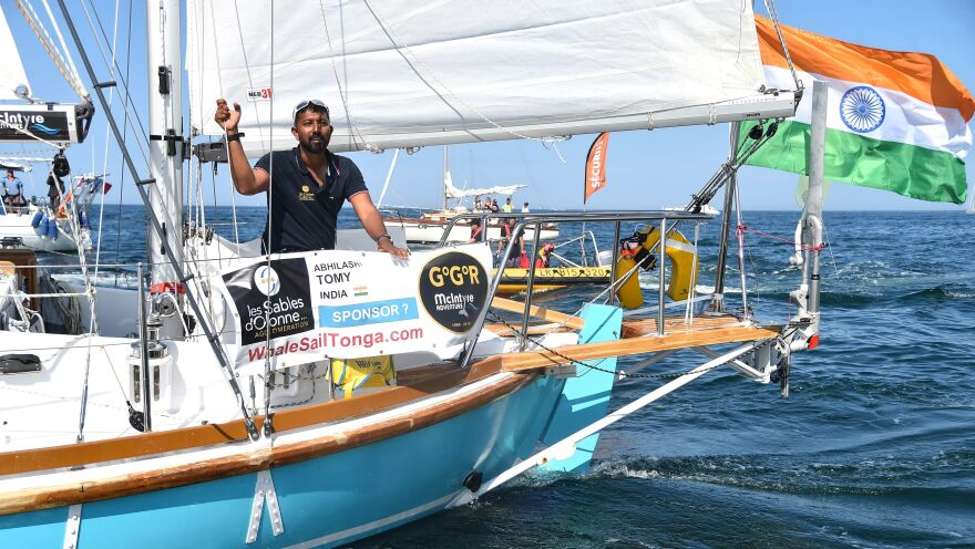 "India's Abhilash Tomy gestures on his boat Thuriya as he sets off from Les Sables d'Olonne Harbour on July 1 at the start of the solo around-the-world ""Golden Globe Race"" ocean race in which sailors compete without high technology aides such as GPS or computers."