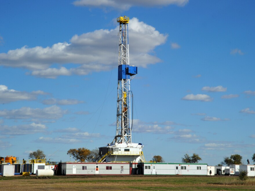 An oil drilling rig is seen near Ray, N.D., last September. The well is being drilled into the Bakken Formation, one of the largest contiguous deposits of oil and natural gas in the United States.