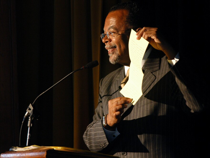 Henry Louis Gates Jr. uses a folded piece of paper to show how information on African American writer Harriet E. Wilson was lost when copied to microfilm, while giving a speech about the author in 2004 at the Milford Town Hall in New Hampshire.