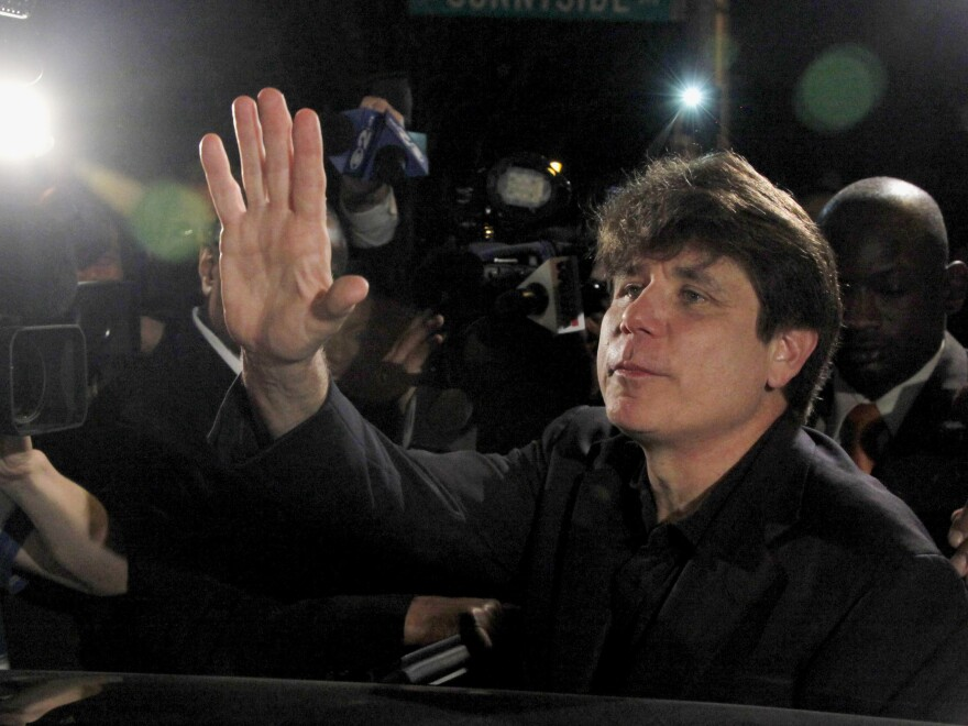 Former Illinois Gov. Rod Blagojevich waves as he departs his Chicago home for Littleton, Colo., to begin his 14-year prison sentence on March 15, 2012. The 7th U.S. Circuit Court of Appeals in Chicago on Tuesday tossed out some of Blagojevich's convictions.