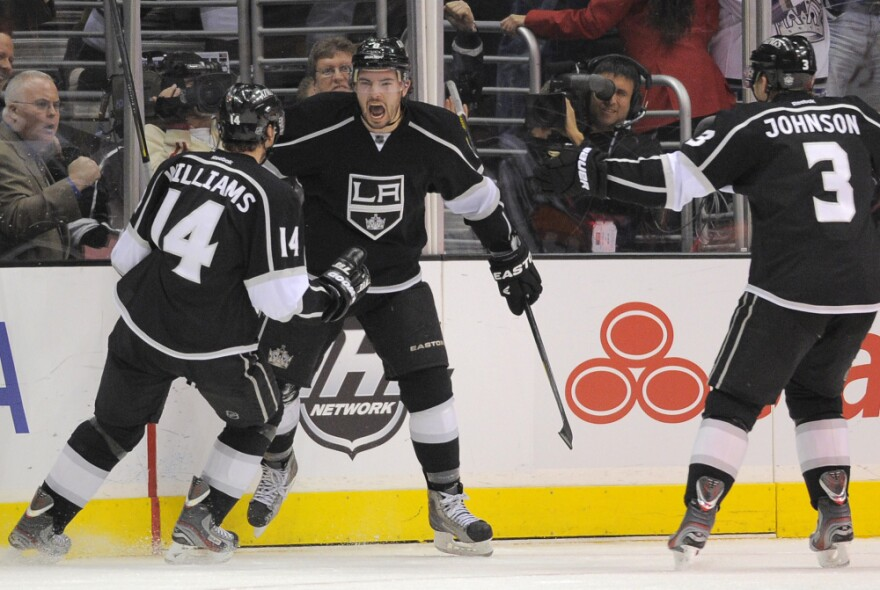 Los Angeles Kings defenseman Drew Doughty, center, celebrates with right wing Justin Williams, left, and defenseman Jack Johnson after scoring the game-winning goal during the third period of their NHL hockey game against the Columbus Blue Jackets on Wednesday.